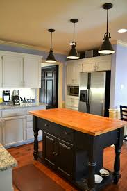 three units of modern pendant lamps by allen roth in black a kitchen island with
