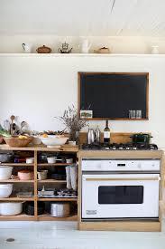 in deborah ehrlich s hudson valley home ad hoc open shelving corrals cookware below the