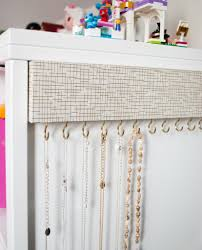 DIY Jewelry organizer for tangle-free necklaces. Cover wood with decorative  paper, screw