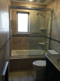 alcove tub mosaic tile surround window in bathroom shower area same size bathtub sizes