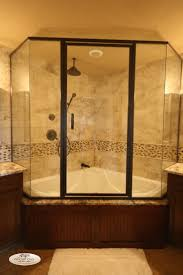 corner tub with shower enclosure. nice corner shower and bathtub combo with glass enclosure - use j/k to navigate previous next images | basement bathroom pinterest tub