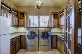 4 tags Traditional Laundry Room with Samsung 4.0 cu. ft. Steam Front-Load  Washer,