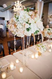 Lovely tall centerpiece. Photo by Helmutwalker Photography.  www.wedsociety.com #centerpiece