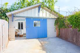 garage barn doorsCar barn garage craftsman with sliding barn doors blue corbels