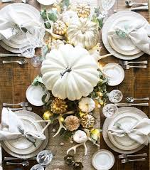 monochrome table setting with metallics and pumpkins