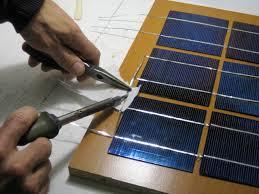 soldering adjacent columns of solar cells for the final solar panel
