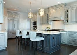 White Washed Kitchen Cabinets With Chair And Wood Flooring And Modern  Chandelier