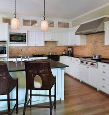 view in gallery contemporary kitchen with a contrasting exposed brick wall and backsplash view