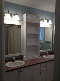 cabinet and lighting. Large Bathroom Mirror Redo To Double Framed Mirrors And Cabinet, Ideas, Home Decor, Shelving Ideas Cabinet Lighting