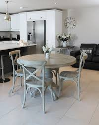 vintage round dining table and chairs for small kitchen decorating ideas with wall clock and white cabinet design