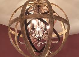 large round wooden orb chandelier with metal orb detail and crystal