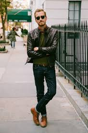 selout of stock nail off duty dressing with this combination of a brown leather er jacket and navy