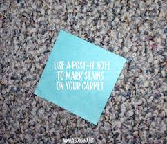 use a post it note to mark stains on your carpet via clean mama
