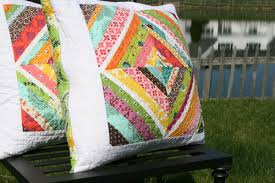 FITF: pillows to match a quilt   Film in the Fridge & I put together four blocks for each pillow and then framed them with white  to make them large enough to fit an 18″ pillow. The back is one of my  favorite ... Adamdwight.com
