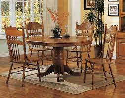 nostalgia 5 piece 42 inch round dining set with press back chairs in light oak finish
