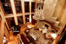 antler chandelier living room with red suede upholstery sofa square table black piano two fabric