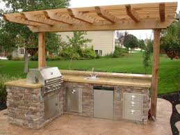 outdoor kitchen with pergola most inspiring design cedar polished finish wooden posts crossbeams rafters roof battens backyard landscape decoration