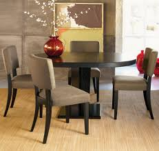 classic black wooden small oval dining table with foam padded wooden frame chairs natural wooden floor