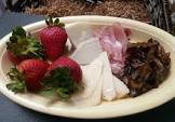 antipasto of prosciutto  cheese  strawberries and balsamic onion