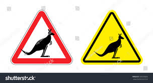 warning sign of attention kangaroo hazard yellow sign jumping marsupials silhouette australian beast on