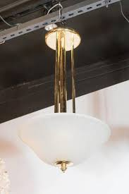 this elegant art deco pendant consists of a ribbed and fluted frosted glass dome supported by