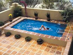 breathtaking simple small and corneric savvy space outdoor swimming pool  with pottery ornaments around: small