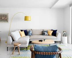 beach style living room furniture. inspiration for a beach style open concept living room in brisbane with white walls furniture