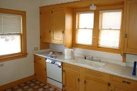 honing in on home improvement paint jobs kitchen cabinet wood cabinets before and after painting