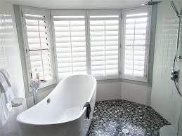 white shutters in modern full bath and shower