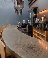 curved concrete countertop in a busy bar in new england gear is placed into the