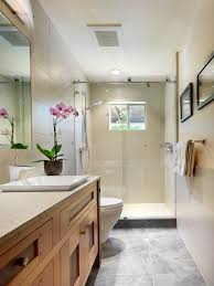 Extended Bathroom Vanity Light To Create A Clean Feel The Designer Tiled The Entire Wall