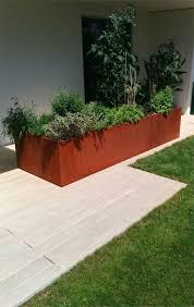Cortenstahl Kamin Sichtschutz Garten Holz Ablage