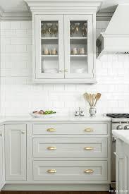 heidi pirron gray kitchen brass hardware white brick pattern tile