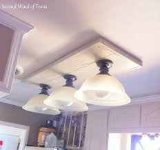 replacing fluorescent light fixture with led three pieve bulbs cover glass material wooden base cover top