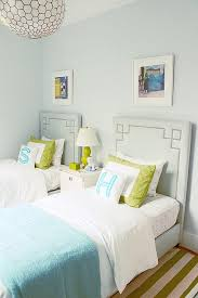 blue and green girls bedroom with turquoise monogrammed pillows