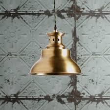 saturn pendant light in antiqued brass