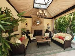Pretty Outdoor Living Room With Black Rattan Chair With White Seat