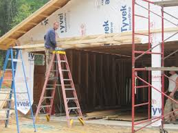 the garage doors have a 2 foot eyebrow roof over them to protect them from rain this is the last of the roof framing