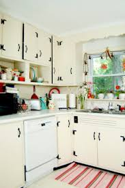 Cream Vintage Kitchen With Exposed Black Hinges And Handles