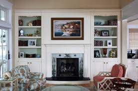 white built in bookcase around fireplace