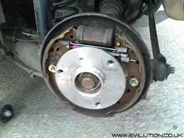 car bearings. looking behind it you will see the thread sides of 4 torx bolts that hold bearing. car bearings