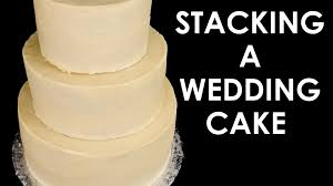 how to make a wedding cake stacking a 3 tier wedding cake part 2 from cookies cupcakes and cardio you