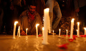 a prayer for peshawar com a man lights candles to mourn victims from army public school in peshawar reuters