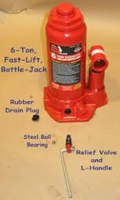 bottle jack oil drained out press farm tools garage car lift