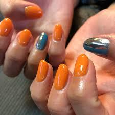 夏ハンドミラーオレンジターコイズ Cotanailのネイルデザインno