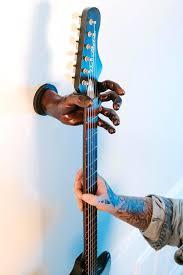 receive off guitar wall hanger ideas grip reaper hand and hooks wooden base guitar hangers wall mount