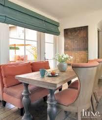 for the breakfast nook davies gaetano designed a hefty wood table and an upholstered bench which she covered with fabrics from lee jofa and hickory chair