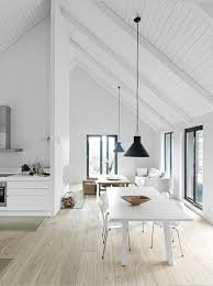 A dash of black is all this white space needed to ground the dining and  living spaces.