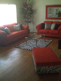red hot living room with zebra print accents this is exactly the look i