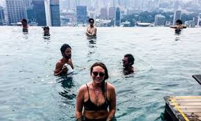 Backpackers boast about sneaking into MBS infinity pool online